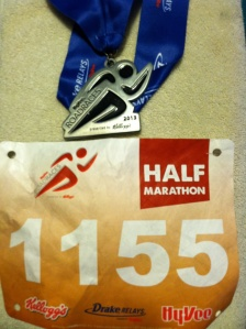 "My ""Good Karma"" finisher medal with my race number"