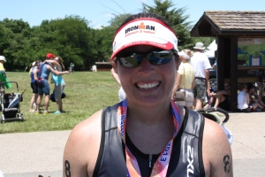 Finishers medal around my neck!!  70.3 miles in 6:05:53...that is nearly a 27 minute PR!!