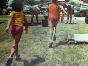 Running in a relay race with a glass of Kool-Aid...I'm the one in the yellow shirt on the left.