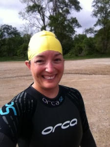Getting ready to immerse myself into the water for my first open water swim of the year.