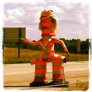"We saw this safety mascot that I named ""Safety Sally"" on the side of the interstate in Kansas City as we were passing through.  It was fun to see that people still have fun on the job...even when serious work is being done!!"