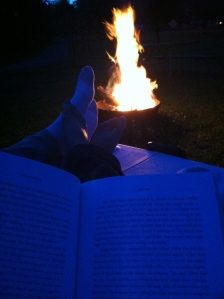 Relaxing by the campfire reading a good book before bed...