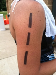 "In transition, I was told by a fellow athlete that my race number (#111) looked like the dotted lines that are painted down the center of the ""highway.""  This would come back to keep me moving forward later in the race!!"
