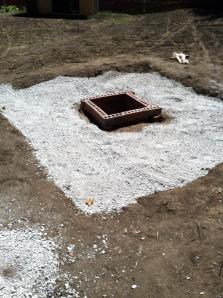 The fire pit is installed and we started to install the crushed gravel around the fire pit in the patio area.
