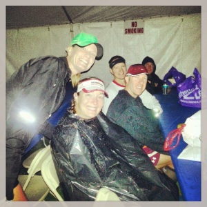 Trying to stay warm and dry as we wait in the tent before the race start.
