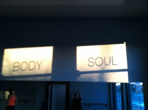 Starting Thanksgiving Day with hot yoga.  With the sunrise coming through the windows, a beautiful silhouette appeared above the mirrors on the wall in the studio.