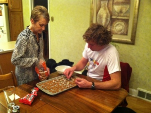 The Iron Hippie and Deb making Holiday Pretzels