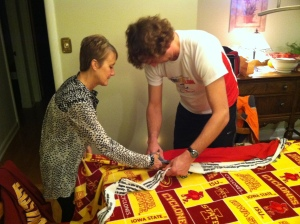 Deb and the Iron Hippie cutting fabric for one of the fleece blankets we made Thanksgiving evening.