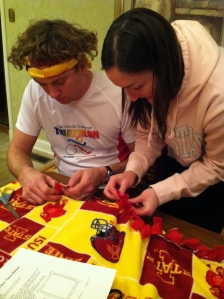 The Iron Hippie and I tying up some of the edges of one of the fleece blankets we made Thanksgiving evening.