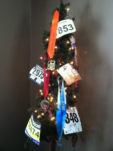 Decorating our Christmas Tree with a VERY SMALL fraction of our race bibs and medals