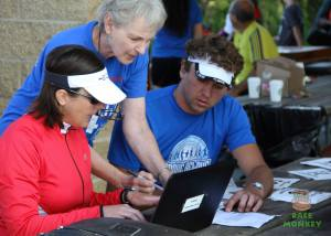 The Iron Hippie and I registering all of the 5K participants.