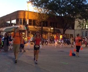 Heading out for loop #2 with Allen jogging beside me.  Photo courtesy of Lora Bierbaum.