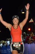 Approaching the finish line of Ironman Wisconsin 2014.  Photo courtesy of Finisherpix.