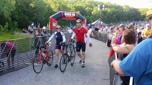 The Iron Hippie and me exiting transition for the bike together.