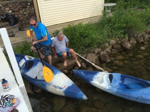 Dad (blue) and Tom (gray) figuring out how to get into their kayaks to escort me on an open water swim