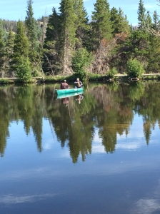 Two men fishing in a canoe at Sprague Lake.