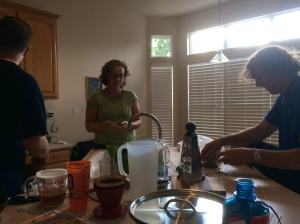 The Iron Hippie, his sister and brother-in-law all in the kitchen enjoying conversation and kitchen prep for tomorrow night's meal.