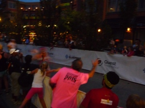 Dad and Sam cheering me on down the finish shoot...yes, that blur is me :)