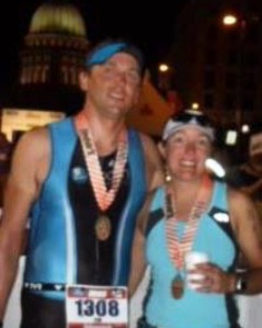 The Iron Hippie and me after crossing the finish line of our first Ironman race at Ironman Wisconsin on September 11, 2011 :)