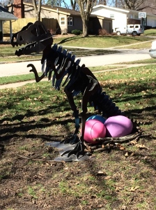 Our neighbors dinosaur yard ornament has laid eggs just in time for Easter!
