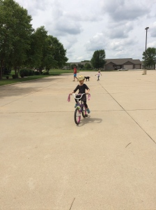 Teaching the twins how to ride their bikes without training wheels!