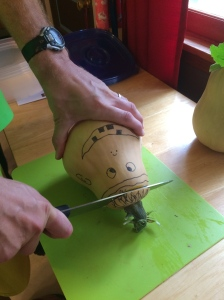Making curry with the homegrown squash...yes it has a face on it thanks to our Swiss neighbors ;)